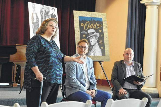 In this file photo, Ariel-Ann Carson Dater Performing Arts Centre Executive Director Lora Snow (left) discusses the McIntyre Suite inspired by Oscar Odd McIntyre, the famed passed Gallipolis columnist and reporter, with McIntyre biography writer Scott Williams (center) and area actor Seth Argabright (right).