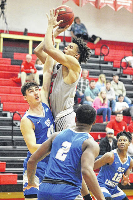 Rio's Greg Wallace gets off a shot over Ohio Christian's Gabe Casey during the second half of Saturday's game at the Newt Oliver Arena. The Trailblazers defeated the RedStorm, 91-78.