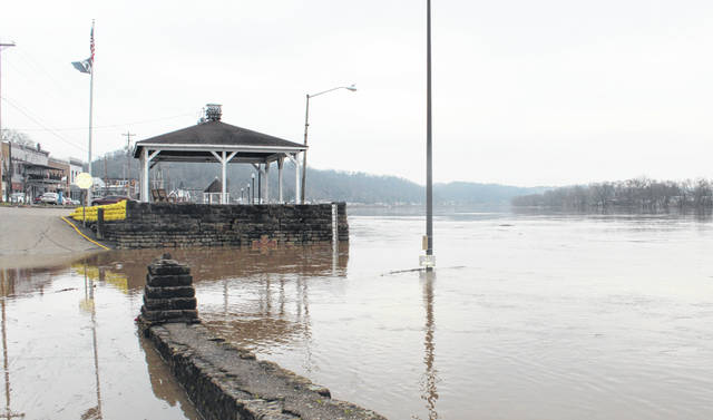 The Ohio River was nearing 40 feet in Pomeroy on Wednesday morning, filling the lower area of the parking lot with water.