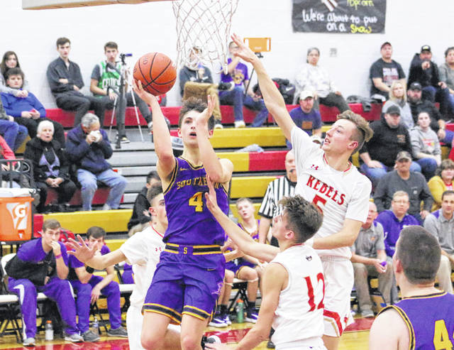 Southern senior Landen Hill (4) releases a shot attempt over South Gallia defenders Jared Burdette (5) and Layne Ours (12) during the second half of a Dec. 17, 2019, boys basketball contest in Mercerville, Ohio.