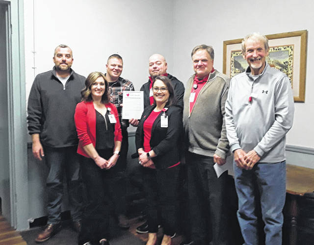 Representatives from Holzer Health System were on hand for the Heart Month Proclamation. The Meigs County Commissioners are pictured with Holzer representatives.