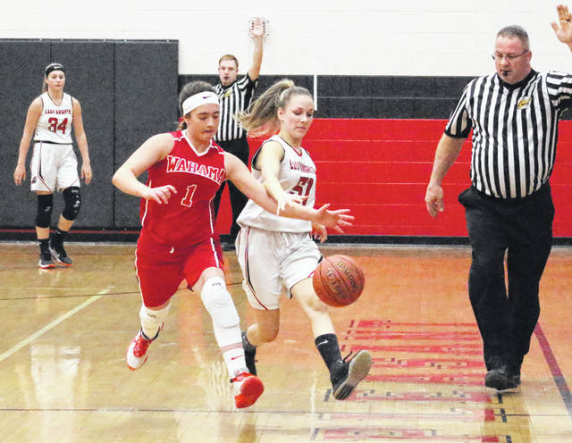 Wahama senior Hannah Rose (1) beats Point Pleasant senior Lena Zellinger to a loose ball during the first half of Thursday night's girls basketball game in Point Pleasant, W.Va.
