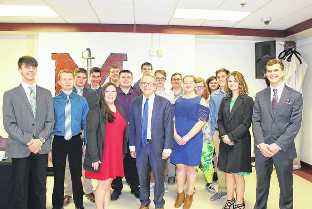 Meigs County high school students in attendance at the dinner are pictured with Governor Mike DeWine.