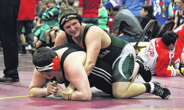 Eastern junior Steven Fitzgerald takes his opponent down during a heavyweight bout at the Meigs Invitational on Jan. 4 in Rocksprings, Ohio.