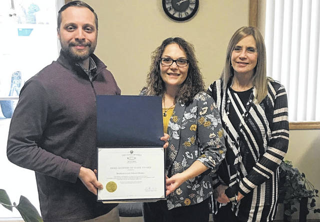 Southern Local recently received the Auditor of State Award. Pictured are Dominic Ciano, Southeast Regional Liaison for the Ohio Auditor of the State, Christi Hendrix, Treasurer, and Cricket Adkins, Assistant to the Treasurer.
