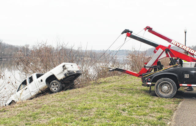 Crews from 33 Auto and Riverside Auto and Towing removed a Pomeroy Village Truck from the river on Monday morning.