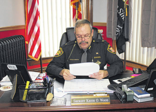 Meigs County Sheriff Keith Wood reads from a prepared statement while addressing the media on Wednesday morning.