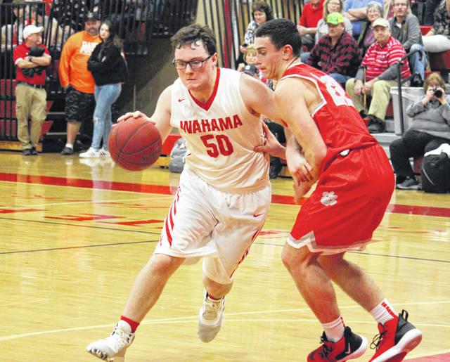 Wahama freshman Michael VanMatre (50) drives past Trimble's Blake Guffey (22), during the Tomcats' TVC Hocking victory on Feb. 4 in Mason, W.Va.