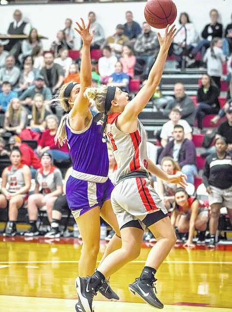 Rio Grande's Reagan Willingham moves past Asbury University's Amie Conley for two of her 14 points in Wednesday night's 90-89 win over the Eagles in the quarterfinal round of the River States Conference Women's Basketball Championship at the Newt Oliver Arena.
