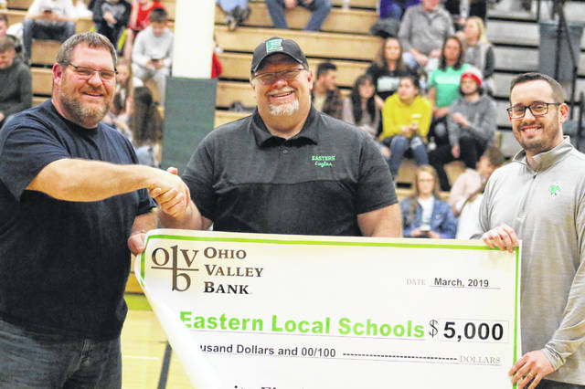 "Representatives from Ohio Valley Bank were in attendance at the boys basketball game on Friday evening at Eastern High School, presenting a donation for new score boards in the gymnasium. As part of the bank's ""Community First"" mission, $5,000 was presented to the school for the scoreboards. Pictured, from left, are OVB Bend Area Region Manager Dan Short, Eastern High School Principal Shawn Bush and OVB Director of Business Sales and Support Tony Staley."