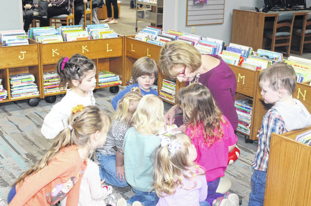 Ohio First Lady Fran DeWine reads to children at the Meigs County District Public Library in Pomeroy on Monday afternoon.