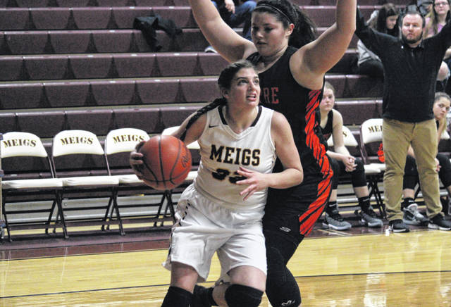 Meigs junior Hannah Durst goes in for a layup during the Lady Marauders' non-conference bout with Belpre on Dec. 30, 2019, in Rocksprings, Ohio.
