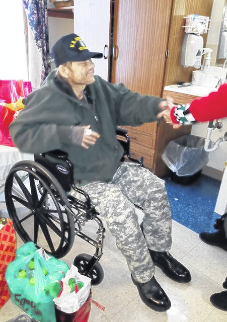 Veteran Anthony Whitlock is pictured with the boots he received for Christmas.