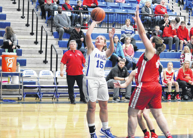 GAHS junior Koren Truance (15) shoots a layup in front of a pair of RHHS defenders, during the Blue Angels' 57-36 victory on Thursday in Centenary, Ohio.