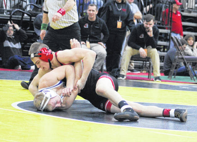 Point Pleasant sophomore Justin Bartee gains leverage on an opponent during a Class AA-A 138-pound match Friday morning at Mountain Health Arena in Huntington, W.Va.