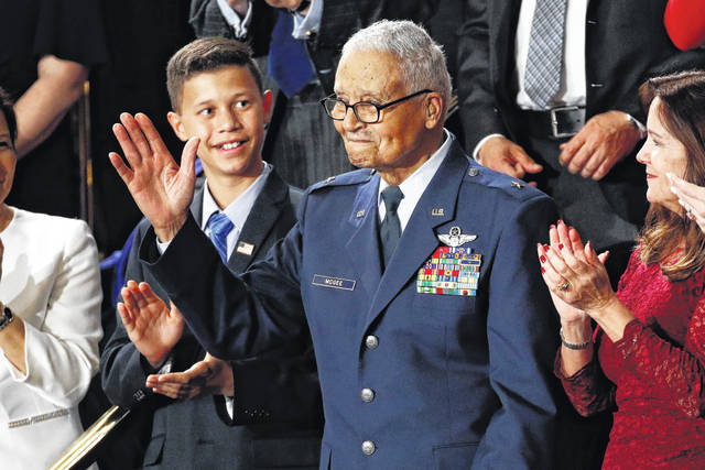 Tuskegee airman Charles McGee, 100, and his great grandson Iain Lanphier react as President Donald Trump delivers his State of the Union address to a joint session of Congress on Capitol Hill in Washington, Tuesday, Feb. 4.
