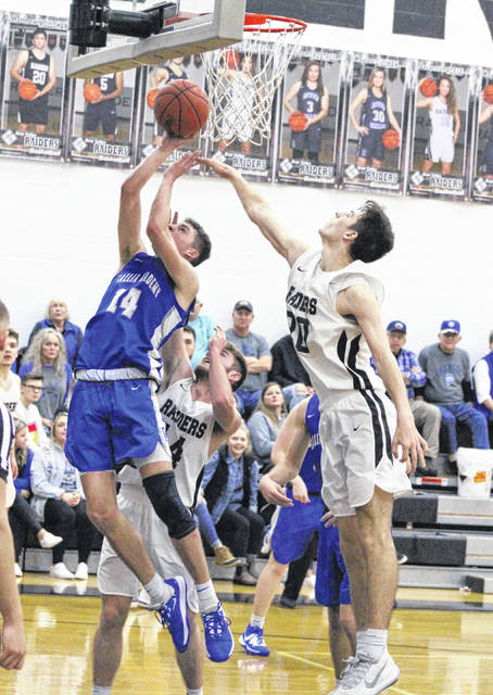 Gallia Academy senior Logan Blouir releases a shot attempt over a River Valley defender during the second half of a Jan. 21 boys basketball contest in Bidwell, Ohio.