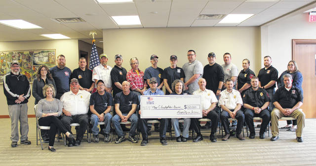 Representatives from 11 of Meigs County's 12 volunteer fire departments were on hand Monday evening to receive the donation from Loyalty is Forever.