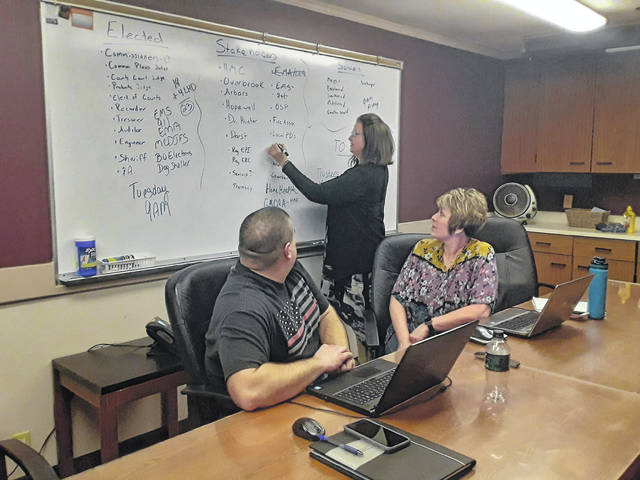 Health Department officials Brody Davis, Courtney Midkiff and Leanne Cunningham discuss the response to COVID-19.