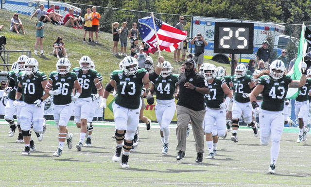 Members of the 2019 Ohio Bobcats run onto the field at Peden Stadium, prior to their Aug. 31 non-conference game in Athens, Ohio.