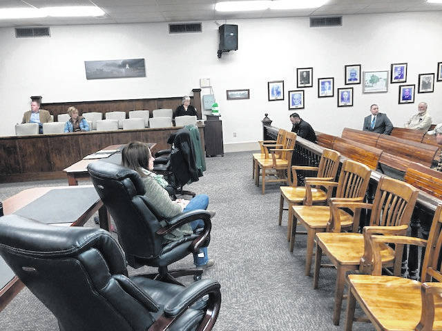 Local officials practiced social distancing this week during a meeting on COVID-19.