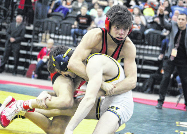 Point Pleasant junior Christopher Smith appears to break free from a hold for a reversal during his 126-pound Class AA-A championship match Saturday night at Mountain Health Arena in Huntington, W.Va.