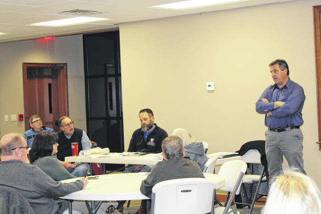 Engineer Mitch Altier addresses those in attendance during last week's public meeting on the 833 Sewer Project.