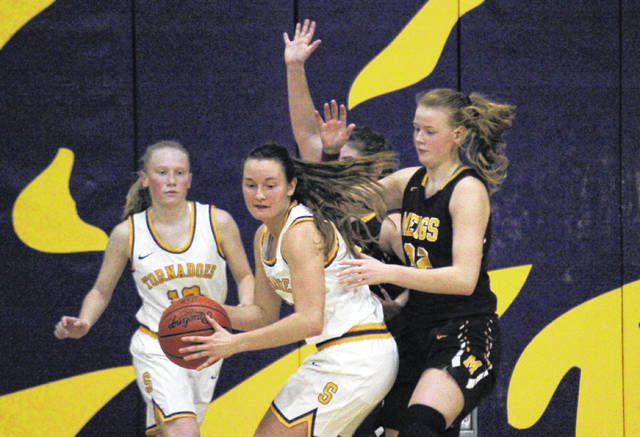 Southern senior Baylee Wolfe (center) works in the low post in front of SHS sophomore Kayla Evans (left) and Meigs sophomore Mallory Hawley (right), during a non-conference game on Nov. 27 in Racine, Ohio.