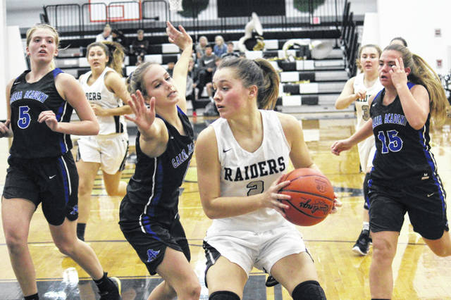 RVHS junior Hannah Jacks (2) is guarded in the low post by GAHS senior Alex Barnes, during a non-conference bout on Nov. 25 in Bidwell, Ohio.