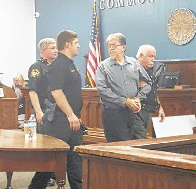 Larry Tucker is led from court in handcuffs following the verdict in his trial in May 2019.
