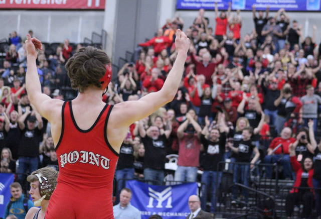 Point Pleasant junior Isaac Short signals the hometown fans after winning the Class AA-A 120-pound championship on Saturday night at Mountain Health Arena in Huntington, W.Va.