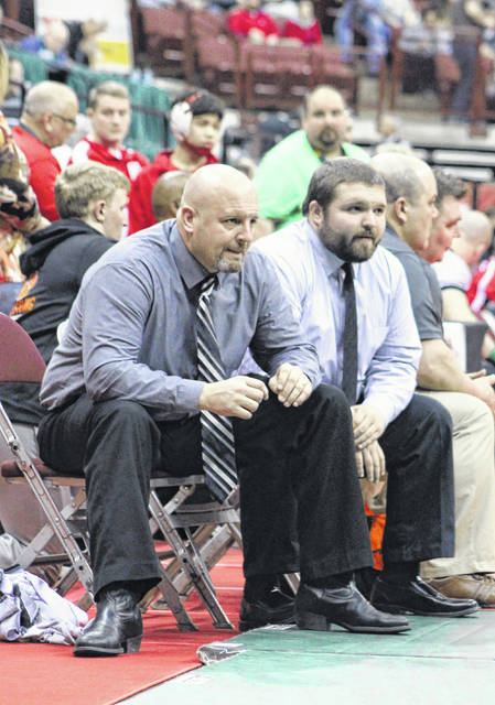 River Valley wrestling coach Matthew Huck, left, watches a match with assistant Mark Allen Jr. during the 2019 OHSAA Individual Wrestling Championships held on March 7, 2019, at the Schottenstein Center in Columbus, Ohio.