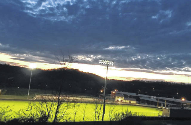 "In unity with schools across the state, the lights at the Meigs High School's Farmers Bank Stadium, Holzer Field were shining bright Monday night in honor of the high school seniors. The lights were turned on starting at 8:20 p.m. (2020 military time) for 20 minutes and 20 seconds. ""We are honored and proud of the hard work dedication, and accomplishments of the Class of 2020 over the past thirteen years,"" said Meigs Local in announcing the event. While the stadium and field remained closed during the recognition, cars drove through the parking lot, honking horns and showing support for the Class of 2020."