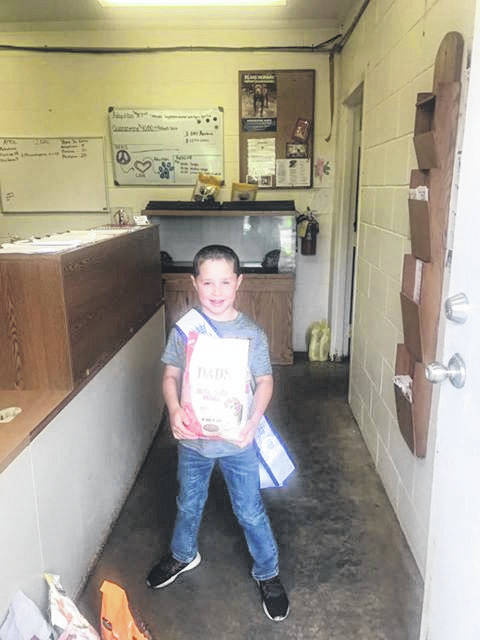 Little Mister Gallia 2019 Hunter Browning, 7, recently donated five bags of dog food to the Gallia Canine Shelter utilizing his own money.