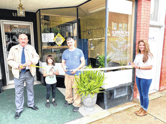 Stuckey's Guppies & More, a pet store and bait shop in downtown Point Pleasant, recently held a ribbon cutting with city officials. Pictured are Mayor Brian Billings, Chloe and William Stuckey and City Clerk Amber Tatterson, celebrating the new business and its inhabitants. Businses hours are Sunday 11 a.m. - 8 p.m., Monday, Tuesday, Wednesday, Friday and Saturday 9 a.m. - 9 p.m., closed on Thursdays. Owners are William and Sonia Stuckey. Stuckey's Guppies & More is located at 514 Main Street. Call 304-812-5182 for more information or find them on Facebook. (Shannon Johnson   Courtesy Photos)