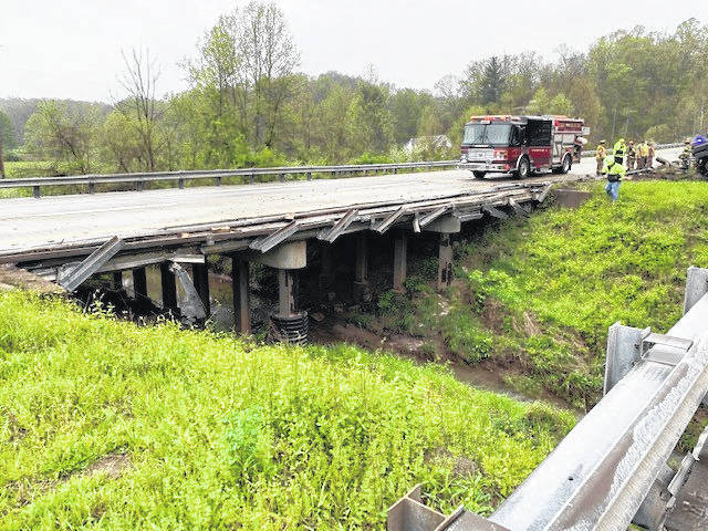 The passing lane of US 33 eastbound is closed between Peach Fork Road (County Rd. 19) and Long Hollow Road (Township Rd. 27A) in Meigs County until further notice for bridge railing repair. The railing was heavily damaged in a crash that occurred on Friday morning. (Photo courtesy of ODOT)
