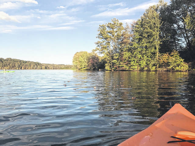 Kayaking at Tycoon Lake prior to the dam construction scheduled for June.