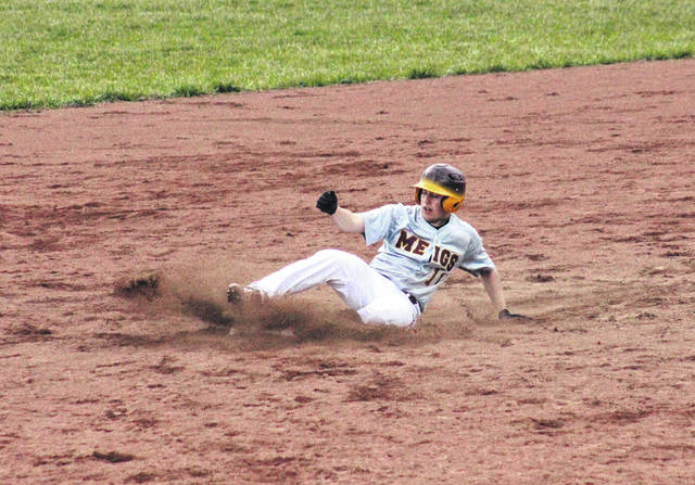 Meigs junior Cory Cox slides safely into second base during the Marauders' win over Belpre on March 28, 2019, in Rocksprings, Ohio.