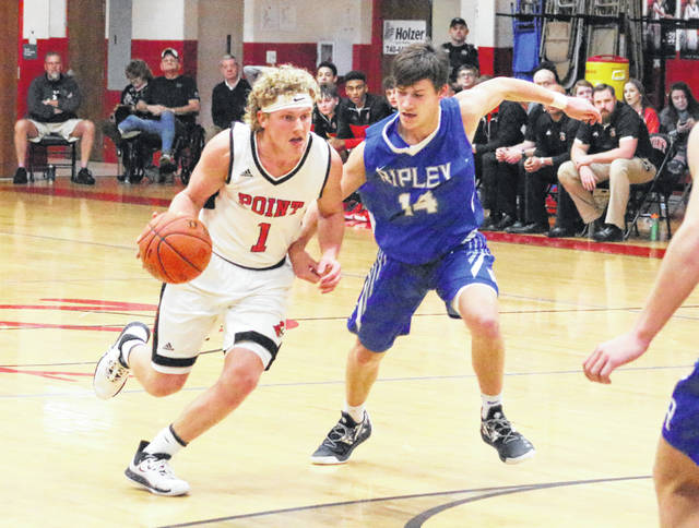 Point Pleasant guard Hunter Bush (1) dribbles past a Ripley defender during a Feb. 4, 2020, boys basketball contest at The Dungeon in Point Pleasant, W.Va.