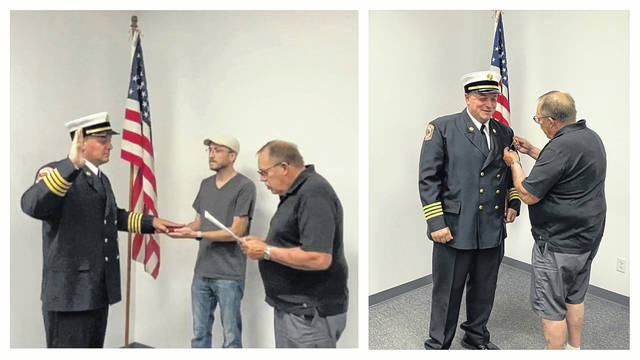 New Pomeroy Fire Chief Derek Miller was sworn in on Monday evening by Mayor Don Anderson. Also pictured is Council President Nick Michael holding the Firefighter's Bible.