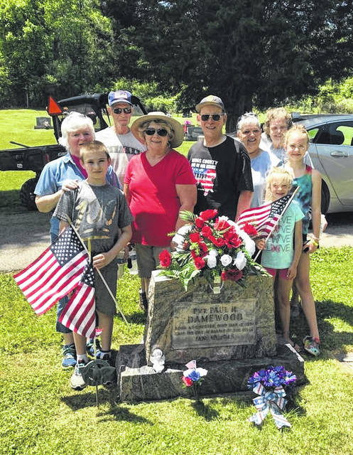 Volunteers recently placed flags on graves of veterans in the Chester Cemetery.