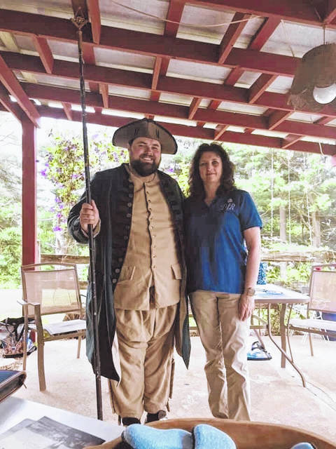 Local historian Jordan Pickens is pictured with DAR Regent Gina Tillis.