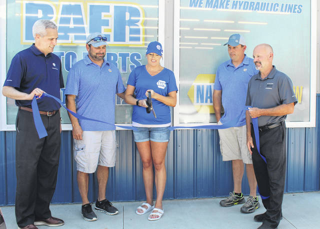 The ribbon cutting and grand opening for Baer Auto Parts, the new NAPA Auto Parts store in Meigs County, was held on Wednesday. Pictured are (from left) NAPA Sales Manager from the Columbus Distribution Center Scott Wood, owners Andy and Talia Baer, manager Matt Milhoan, and NAPA Territory Sales Manager Steve Murphy.