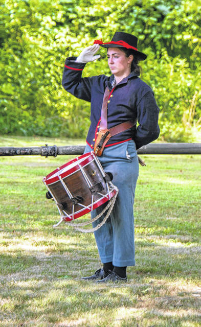 This reenactor portrays a Civil War drummer. Historically speaking, many of the drummers were often very young boys.