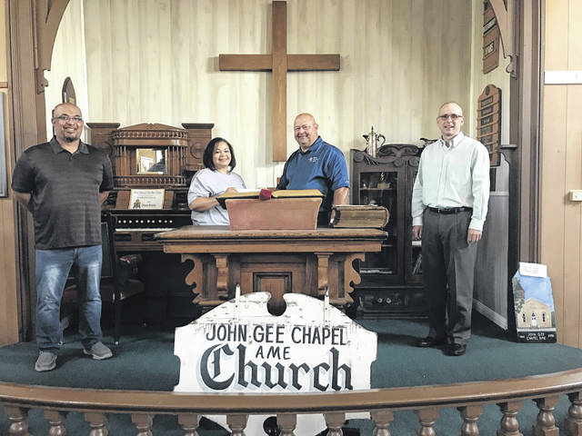 Tom Wiseman, chairman and CEO of Ohio Valley Bank and Larry Miller, OVB president and chief operating officer, pictured third and fourth from left, present a donation to the John Gee Black Historical Center represented by Robin Payne and Pastor Christian Scott. OVB has sponsored the seating in the center and has purchased a corporate membership.