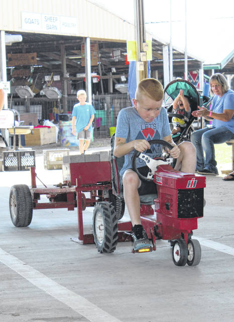 John Turley pedals during the 2019 Meigs County Fair Kiddie Tractor Pull of Champions.
