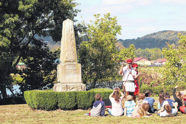 Students at Battle Days hear from reenactors near the monument for Chief Cornstalk. (OVP File Photo)