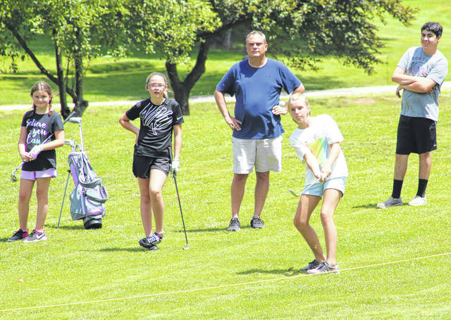 Alli Norris of Racine hits a chip shot onto the ninth hole during a June 25 round of the 2020 Meigs Golf Course Junior League in Pomeroy, Ohio.