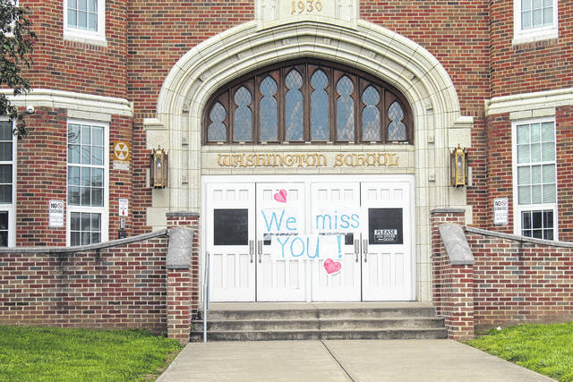 Staff from Washington Elementary placed this sign on the school's closed doors this spring. (OVP File Photo)