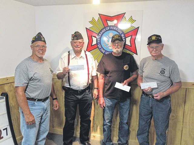 VFW Post 9053 in Tuppers Plains recently presented its 2020 scholarships. Due to the pandemic this year, the grandfathers of the recipients accepted the scholarships on behalf of the recipients. Pictured, Commander Charlie Mugrage presents the scholarships to Randy Reiber receiving for Gabrielle Beeler, Roger Holter receiving for Mallory Holter and Jack Coughenour receiving for Rebecca Little.